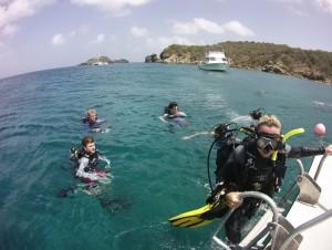 diver getting back on boat